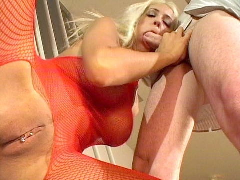 Trina Michaels has a pierced clit hood and tongue and she\'s wearing nothing but a red fishnet bodystocking, but all of that pales in comparison to the perfect round rib cushions she\'s hiding! We\'re treated to fantastic views of her tight pussy as she sucks a meaty cock, but it\'s not until halfway through the scene that we\'re finally treated to her bare beauties! Finally, they\'re covered in cream as she squeezes them together!video