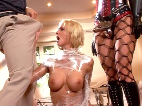 Pornstar Hannah Harper and Taryn Thomas are two anal queens up for some depravity. Hannah got wrapped up head to toe in some clear cellophane and then got ready for some mental domination by Van. There\'s a lot of anal in this scene and plenty of kink to go around. video