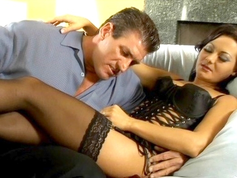 Sandra Romain dressed up in a sexy black dress and black hosiery for this scene. We love hearing that sexy Romanian accent of hers. She gave Lee a no-hands blowjob and fucked him cowgirl before doing her trademark anal. She stroked him off and he spurted all over her little hand. video